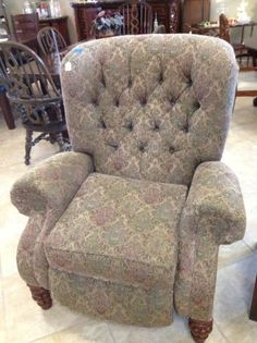 Gorgeous rich tapestry like fabric in sage and tan tones cover this low leg, wing back style recliner. In new condition. Stop in to check out the coordinating elegant camel back sofa with rich walnut toned wood casing on the English style arms. ~$295    Yesterdays Treasures Consignment  5829 Lone Tree Way Suite J  Antioch  925 - 233 - 4547