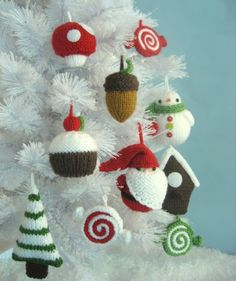 Knitting Patterns for Amigurumi Christmas Tree Ornaments - Pattern includes instructions for the following knit ornaments: Santa, Pepperments, Snowman, Acorn, Tree, Birdhouse, Mushroom and Cupcake. Sizes from 2.5 inches to 5 inches tall.