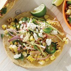 Charred Corn Tacos with Radish Zucchini SlawIngredients 4 ears Sunshine SweetCorn Extra virgin olive oil,as needed Salt and freshly ground pepper, as needed 1/2 cup torn cilantro, parsley and mint leaves1/2 small red onion, thinly sliced2 1/2 tablespoons fresh lime juice 1 teaspoon maple syrup 1 cup radishes, cut into matchsticks1 small zucchini, cut into matchsticks1 jalapeno, seeded and thinly sliced 1/2 cup (2 1/2 ounces) crumbled Cotija or feta cheese10 to 12 small (6-inch) soft corn