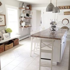 beautiful white and wood kitchen by @roomsforrent