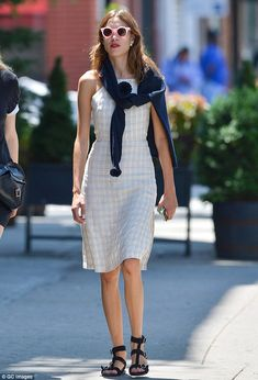 Looking snappy! Alexa Chung put her preppiest foot forward when she headed out in New York City on Monday in a conservative dress and sweater tied around her neck