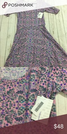 LuLaRoe Nicole This amazing dress features a fitted body, scoop neckline, and a full circle mid length skirt. The pink background is accented by pastel floral print. LuLaRoe Dresses Long Sleeve