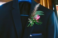 We love the way buttonholes are evolving - this one features a magenta David Austen rose surrounded by leafy gum, penny sedum and peppercorn berry. www.jademcintoshflowers.com.au www.cavanaghphotography.com