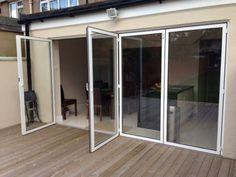 Aluminum bi-folding doors with 1 swing and 3 sliding panels.