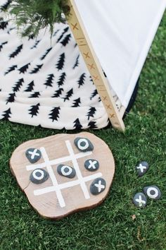 Play Tic-Tac-Toe using stones + a wood slice at your kids camping themed birthday party.