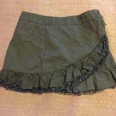 Ruffle layered green skirt A green skirt 100% cotton . Has a layer with another floral layer . With side zipper and button closer. Charlotte Russe Skirts