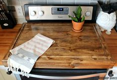 a DIY wooden stove top cover and add more counter space to your kitchen! How to Build a Stove Top Cover with Juice GrooveHow to Build a Stove Top Cover with Juice Groove Electric Stove Top Covers, Gas Stove Top Covers, Wooden Stove Top Covers, Stove Burner Covers, Kitchen Sink Cover, Kitchen Stove, Kitchen Island, Kitchen Cabinets, Stove Board