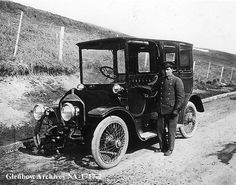 1910 Chauffeur and rented automobile of Motor Livery, Calgary, Alberta. Note cover on hood of automobile.