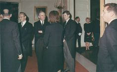 Mrs. Kennedy greets guests at the White House funeral reception, November 25, 1963
