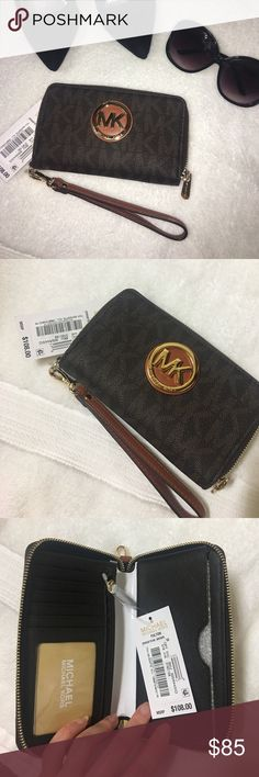 BRAND NEW Michael Kors jet set wristlet New with tag. Purchased at retail price of $108 + tax. Jet set large smartphone wristlet. Has 6 pocket for cards, zipper for coins, and right side for holding the cash. Very popular!! Michael Kors Bags Clutches & Wristlets