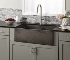 Form with function. This lightweight concrete farmhouse sink not only looks good but is also hard-working, with two deep bowls and simple maintenance. Installs as apron front or behind the counter.