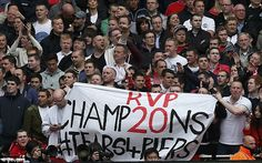 Manchester United fans unveil a banner at the Emirates Stadium