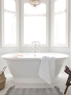 Bathroom refresh with pottery barn, hydrocotton towels, rattan stool, freestanding tub, Benjamin Moore paper white - Bathroom Flooring Mold In Bathroom, Wood Bathroom, Bathroom Colors, White Bathroom, Small Bathroom, Bathroom Ideas, Bathroom Hacks, Bathroom Cabinets, Minimal Bathroom
