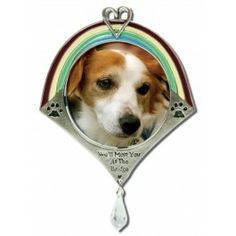 "Endearing pewter pet photo ornament to remind you that your forever friend will meet you at the ""Rainbow Bridge"".  Ornament is adorned with a rainbow and adorable heart and paw prints. $14.99"