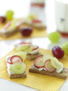 Top graham crackers with cream cheese and Grapes from California to make these simple Graham Cracker Grape Sandwiches