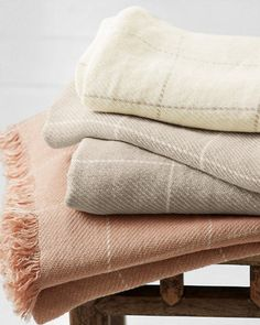 Place a warm blanket or throw at the end of each bed. Windowpane Linen Throw
