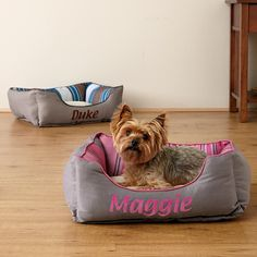 Stripe Box Cuddler - Perfect for your family pets, our warm and cozy bed has a super-soft, comfy pixel fabric sleep surface, a velvety faux suede exterior, and stripes inside for a touch of style. Choose from blue and pink stripes.
