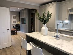 So in love with the new panelling and bookcases. We had them painted in Moles Breath to match the kitchen island to tie the… Open Plan Kitchen Living Room, Kitchen Family Rooms, New Kitchen, Kitchen Decor, Kitchen Island, Kitchen Ideas, Shaker Kitchen, Country Kitchen, Grey Kitchen Floor