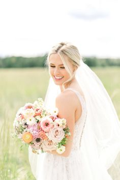 This beautiful fine art bridal portrait in Fish Creek Park #calgary shows our joyful bride holding her handtied bouquet of blush and peach blooms including butterfly ranunculus, ranunculus, anemones, yarrow and peonies. Photo @emilyj0nes  #fineartwedding #butterflyranunculus #calgarywedding #calgarybride #calgaryflowers #weddingbouquet Fish Creek Park, Ranunculus, Bridal Portraits, Bridal Bouquets, Floral Wedding, Floral Design, Peach, Bride, Wedding Dresses