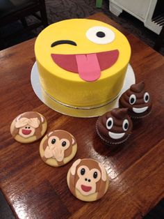 Emoji cake, cup cakes and cookies