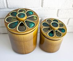 Vintage pottery kitchen canisters.