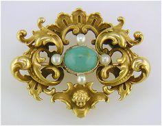 Victorian gold Rococo Revival Cherub and Turquoise Brooch, circa 1870