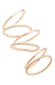 Six simple rings in a rose-goldtone plate are extra pretty when layered and look great on their own, too.