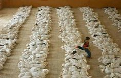 astaghfirullahalazim...INNA LILLAHI WA INNALILLAHI ROJIUN  6 Rajab 1433/27 May 2012  SHOCKING!!  Those are not sacks of rice. Those are dead bodies, mostly children, massacred by Bashar's regime yesterday in full view of the world that continues to remain silent on Syria. Until when? What more will it take?  Spread this pic for awareness and keep the people of Syria in your dhoa!!  I WANT EVERY SINGLE MUSLIM BROTHERS AND SISTERS TO SHARE THIS AND MAKE DHOA...