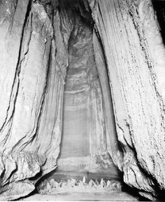While drilling the elevator shaft to Lookout Mountain Caverns in 1929..another cave was intersected at the 160' level.  Leo Lambert explored this cave and discovered a waterfall at the end which he named after his bride ... Ruby Falls 145' tall