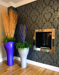 Vortex planters used to create a corner piece in a living-room http://www.livingreendesign.com/category/31-vortex.aspx