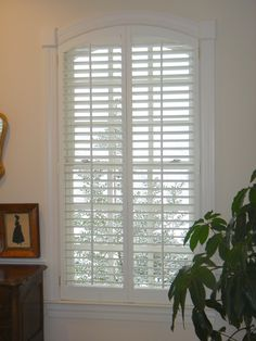 Our beautiful shutters are custom matched to the trim work of this home.  Beautiful arched windows.