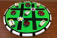Painted rocks Tic Tac Toe.ladybugs and bumble bees