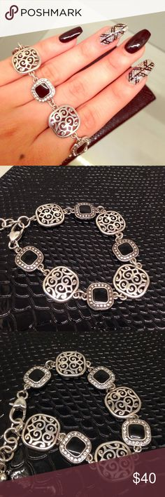 Brighton black & silver bracelet Brand new. Front features filigree pattern and small black squares surrounded by rhinestones. The only difference on the back is the lack of sparkling rhinestones. Beautifully detailed. Bundle and save!! 😊 Brighton Jewelry Bracelets