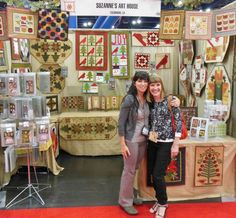 Suzanne and Michelle in the Suzanne's Art House trade show booth... International Quilt Market ...