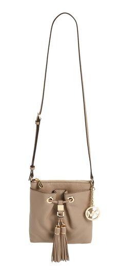 Swingy double tassels add a boho vibe to this drawstring-style bag by Michael Kors.