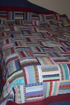 scrappy quilt made from mens shirts....great way to recycle!!  Quilt Green!!!