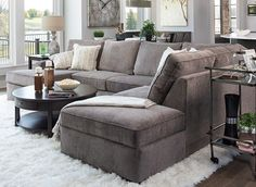 Open floor plan living room with medium gray sectional and loads of texture.