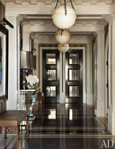 This entry has been an inspiration for so many of our designers! The pendants especially. In the entry hall of a Chicago apartment designed by Jean-Louis Deniot, oak doors inset with antiqued mirror lead to the kitchen and private quarters.
