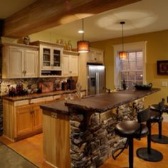 Stone kitchen island pendant and recessed lighting raised cabinets with crown molding