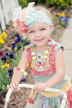 Adorable outfit, headband, necklace, child, and photography!