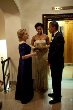 Secretary of State Hillary Rodham Clinton chats with President Barack Obama and First Lady Michelle Obama prior to the state dinner for Prime Minister Manmohan Singh of India and his wife, Mrs Gursharan Kaur, Nov. 24, 2009. (Official White House Photo by Pete Souza)  Most iconic Pete Souza photos of Obama family's first 4 years in the White House