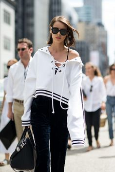 Street style from SS17 New York Fashion Week. Your style takeout? Lace-up details reboot the humble hoodie