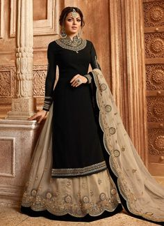 Bollywood diva drashti dhami style black designer lehenga style suit online which is crafted from satin georgette fabric with exclusive embroidery, zari and stone work. This stunning designer lehenga style suit comes with net bottom and net dupatta. Black Lehenga, Lehenga Suit, Lehenga Style, Party Wear Lehenga, Party Wear Dresses, Salwar Suits, Net Lehenga, Party Wear Gowns Online, Gown Dress Online