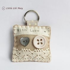 "Vintage With Lace Keyring - Made By Little Lili May - Listed On Feb 28, 2012 On https://Folksy.com - Sewn w/wool blended felt, embellished w/""with love"" ribbon, little buttons, cream lace ribbon, a split ring keyring attached to beige spotty grograin ribbon. Lightly padded w/polyester filling. - Item no longer available. (02.12.15)"