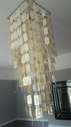 Monsoon Capiz shell Chandelier lampshade...lovely for graces room maybe