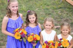 Junior bridesmaids, and flower girls with their bouquets by Boulder Blooms.