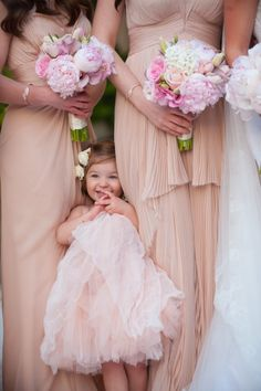 Adorable photo of the flower girl with bridesmaids Photography: Simone And Martin Photography