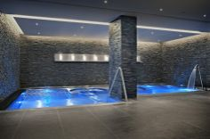 Indoor pool at Schweizerhof Spa, Bern Switzerland - mkv design. Dark stone interior