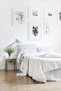Fresh bedroom setting with impressive art wall via Suvi Sur Le Vif..