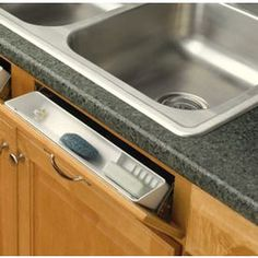 Flip Tray Where False Drawer Is In Front Of Sink. Had One Of These Years
